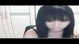 Una mora asiatica impaziente in webcam